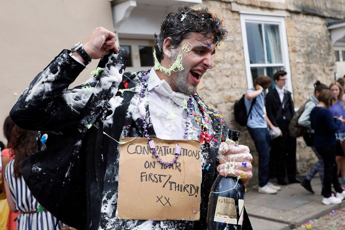 A student from University College Oxford gets 'trashed' after finishing his exams.