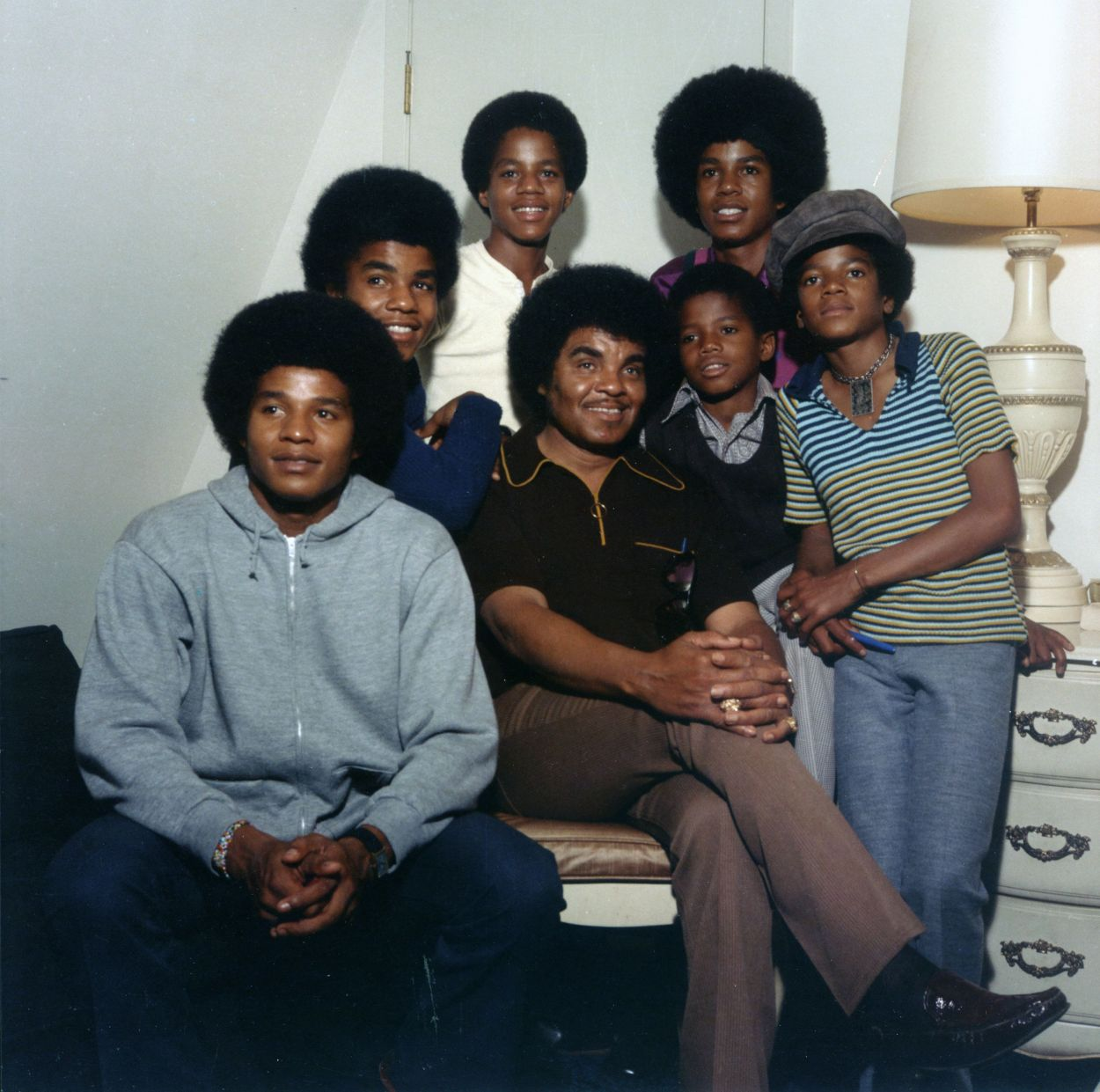 Clockwise from bottom left: Jackie, Tito, Marlon, Jermaine, Michael, Randy and Joe Jackson pictured soon after landing a