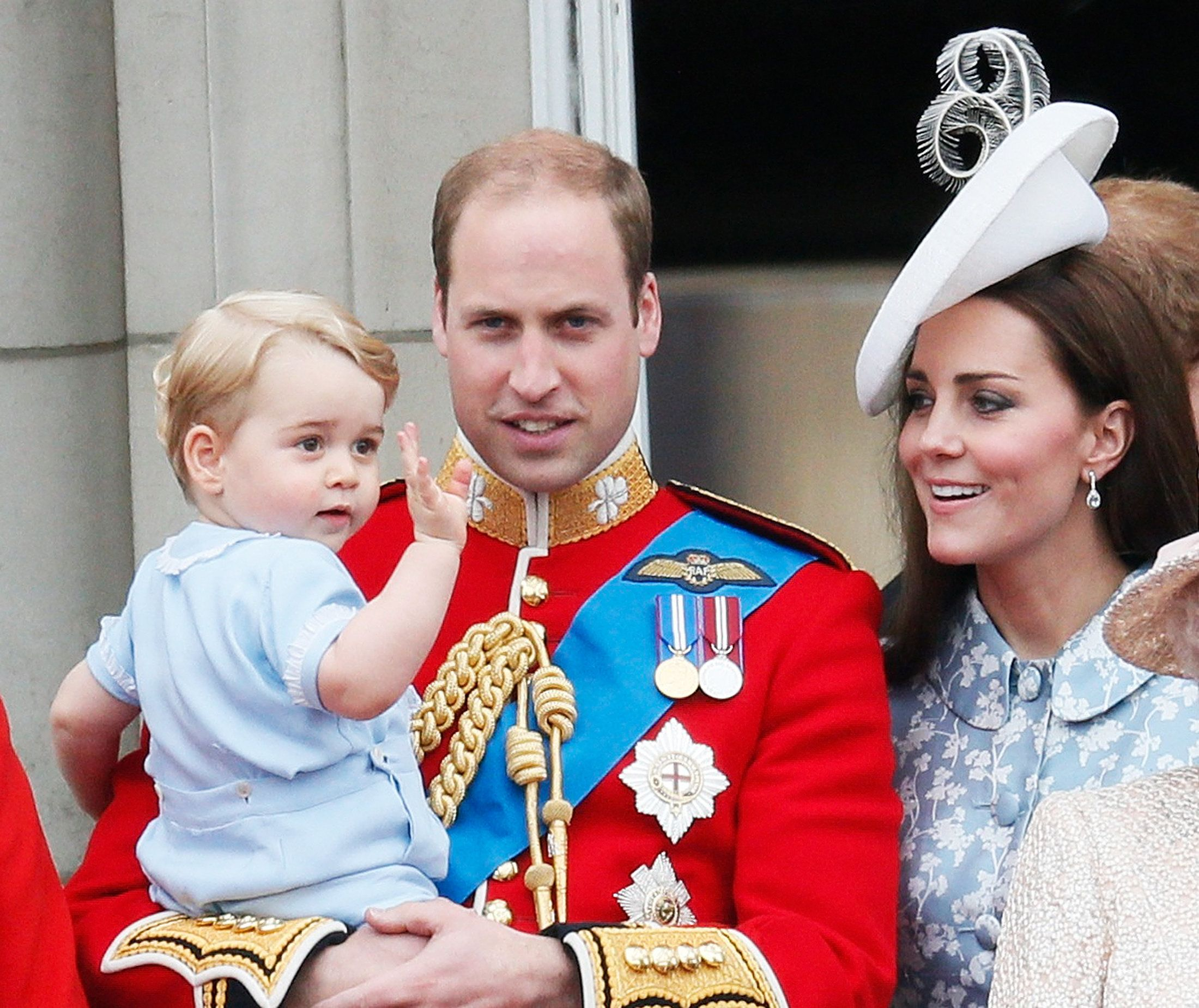 Prince William holds Prince George as he waves on the balcony at Buckingham Palace after the Trooping the Colour ceremony at