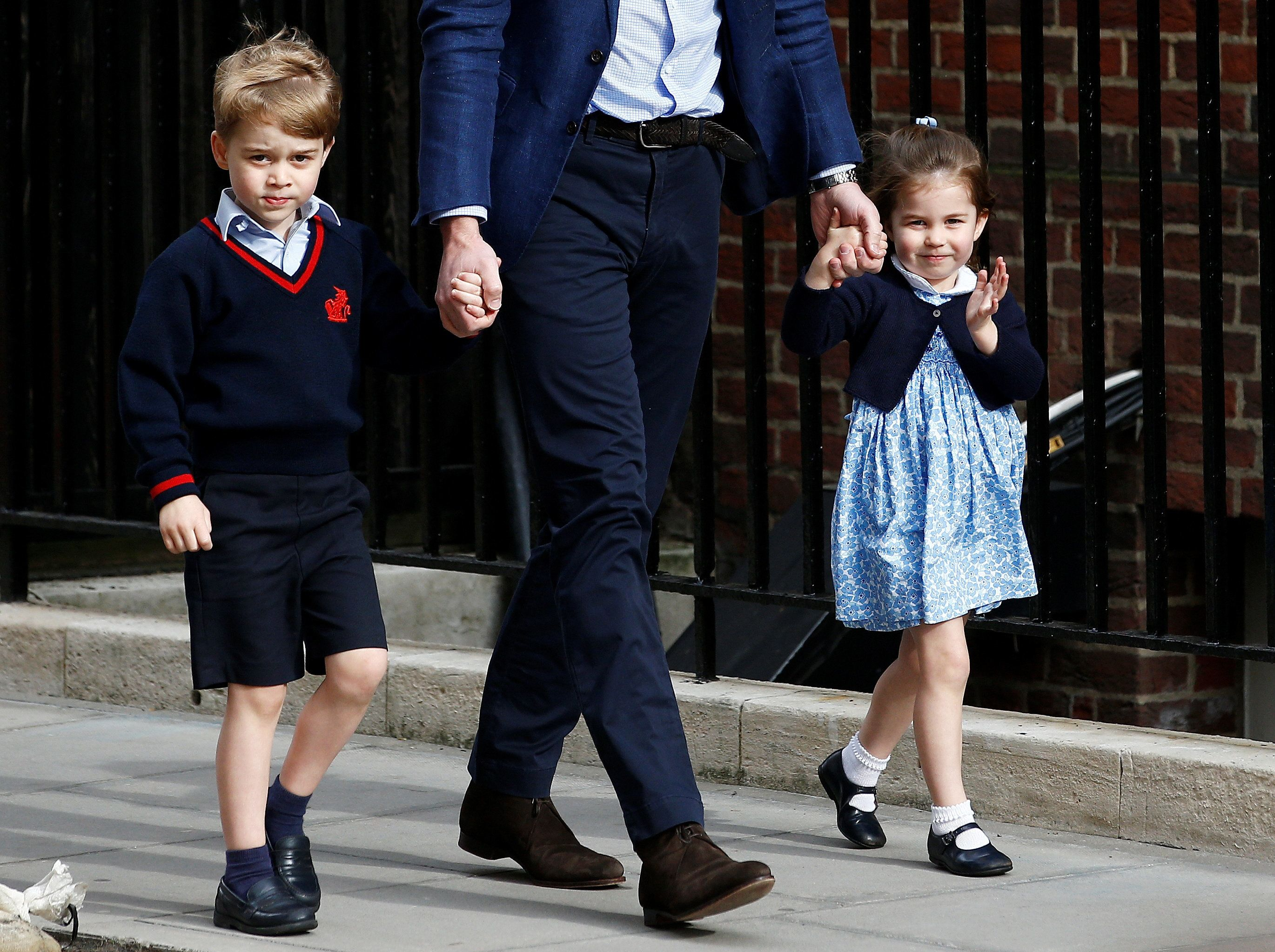 Prince George and Princess Charlottearrive at the Lindo Wing with their father, Prince William, after their mother gave
