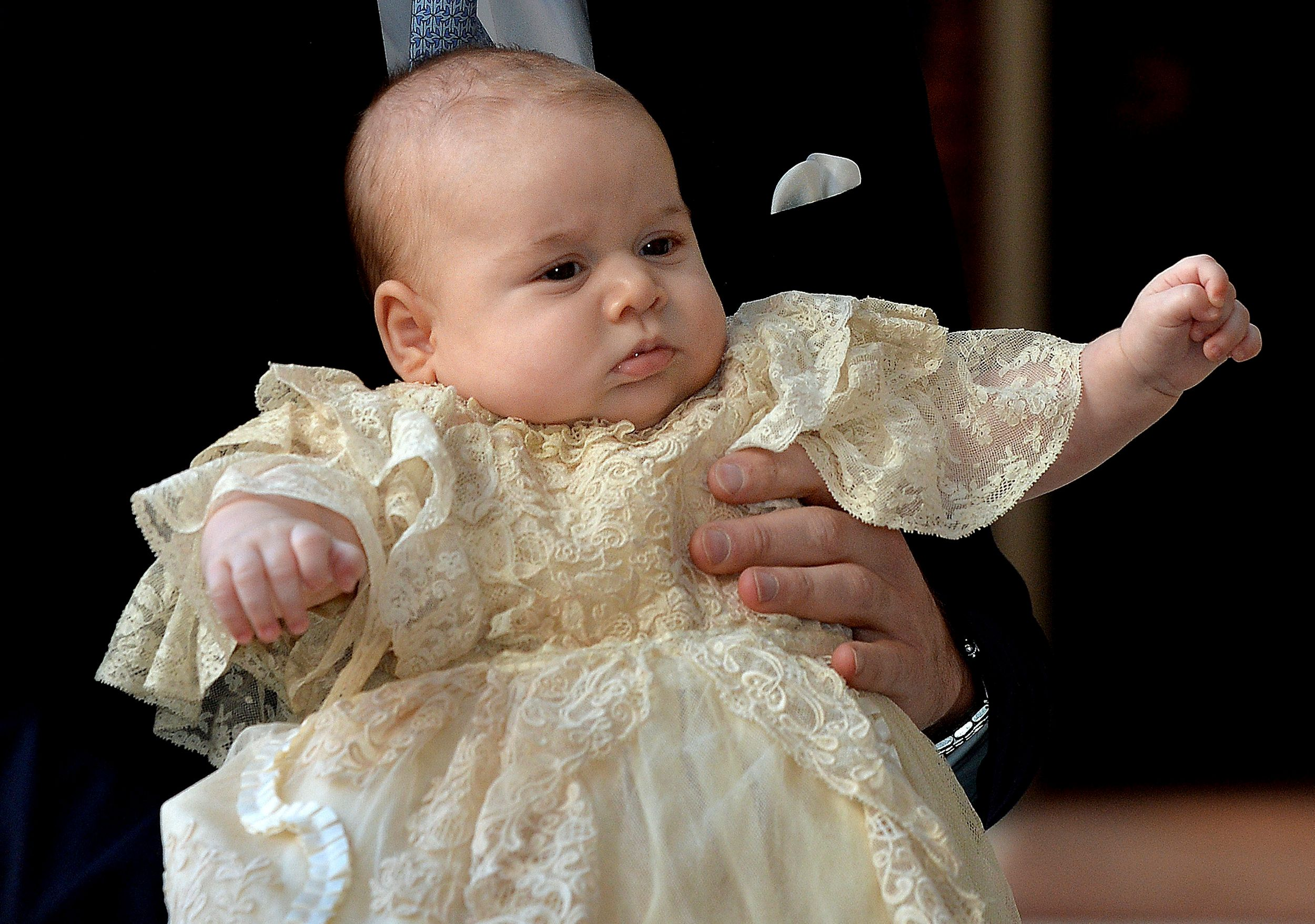 Prince William carries Prince George as they arrive for his christening at St James's Palace in London onOct. 23, 2013.