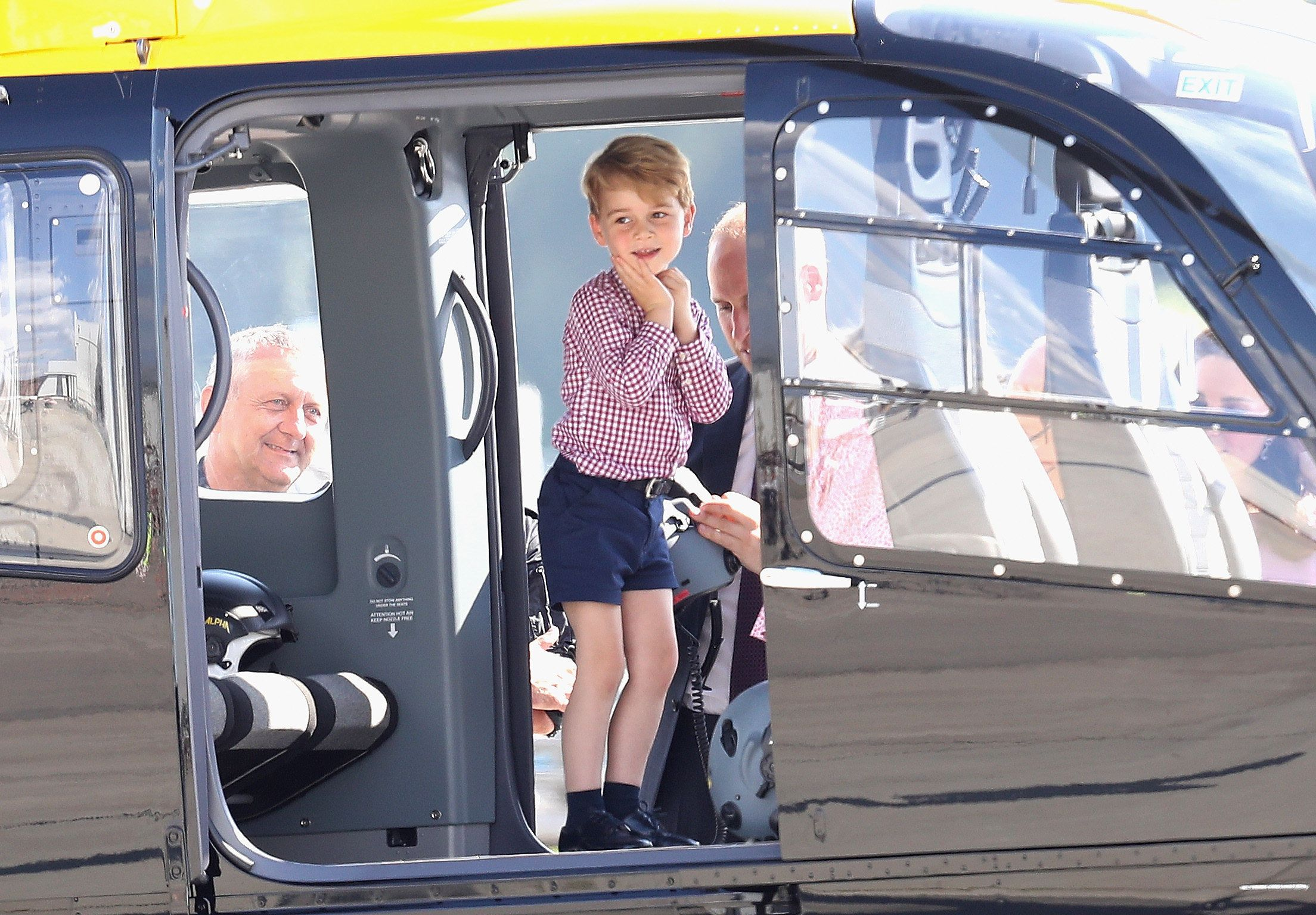 Prince George views helicopter models before departing from Hamburg, Germany, airport on the last day ofthe family's&nb