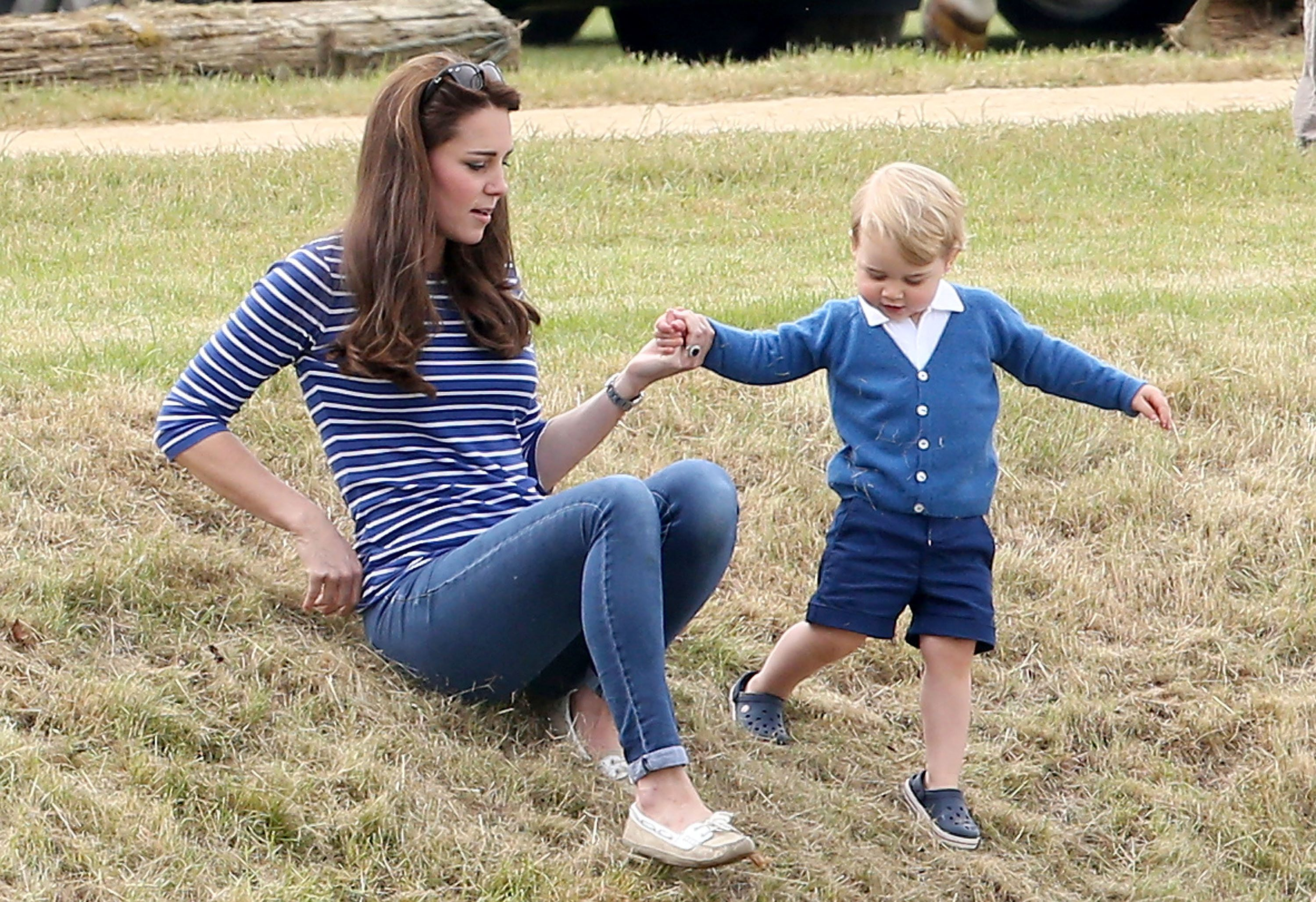 TheDuchess of Cambridge and Prince George attend the Gigaset Charity Polo Match on June 14, 2015, in Tetbury, England.