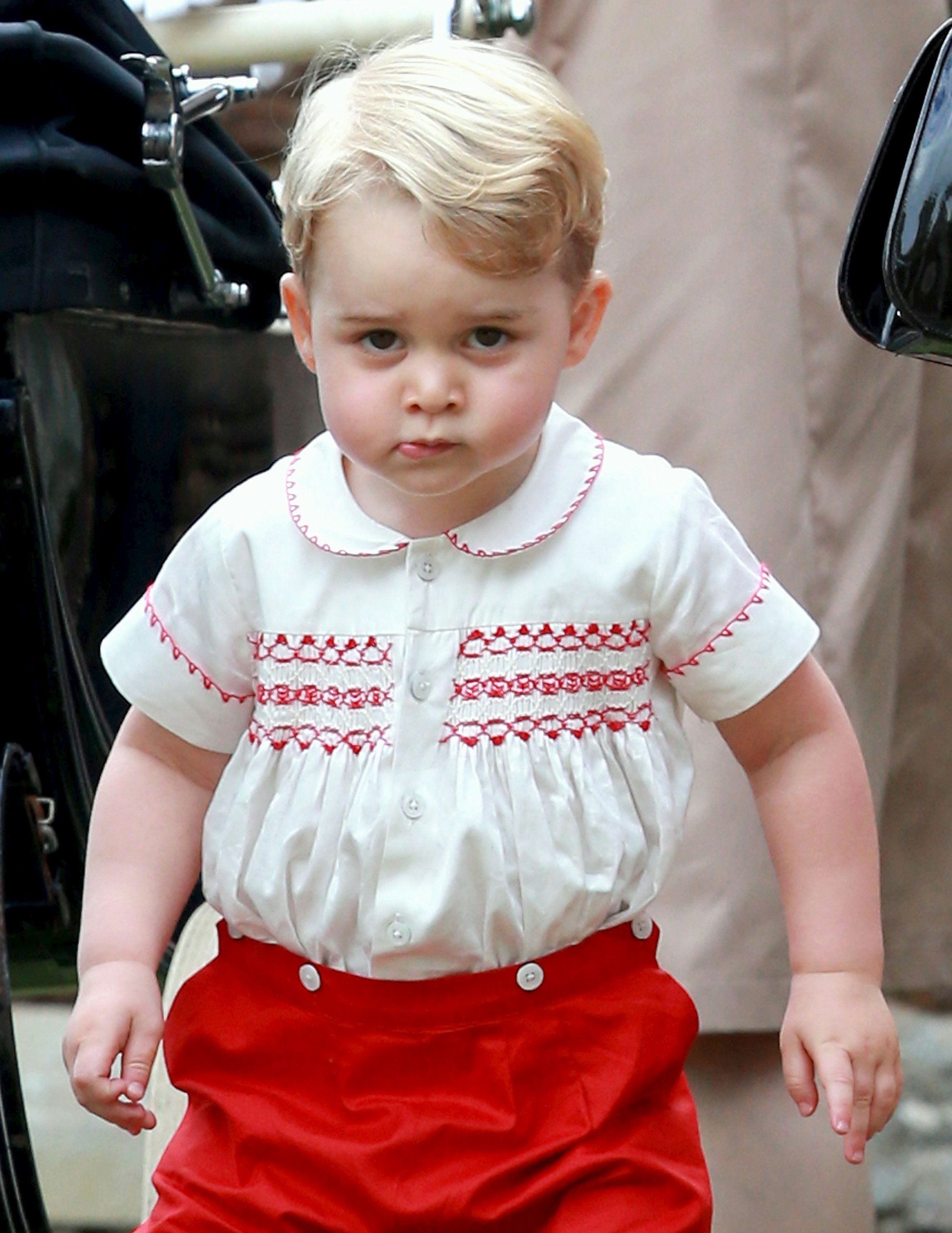 Prince George leaves the Church of St. Mary Magdalene on the Sandringham Estate for the Christening of Princess Charlotte on