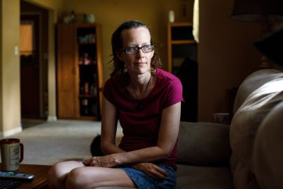 Meredith Lawrence sits in the living room of the home in Gainesville, Georgia, that she bought after her husband's death
