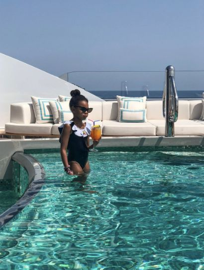 Blue Ivy pictured in a pool on the yacht.