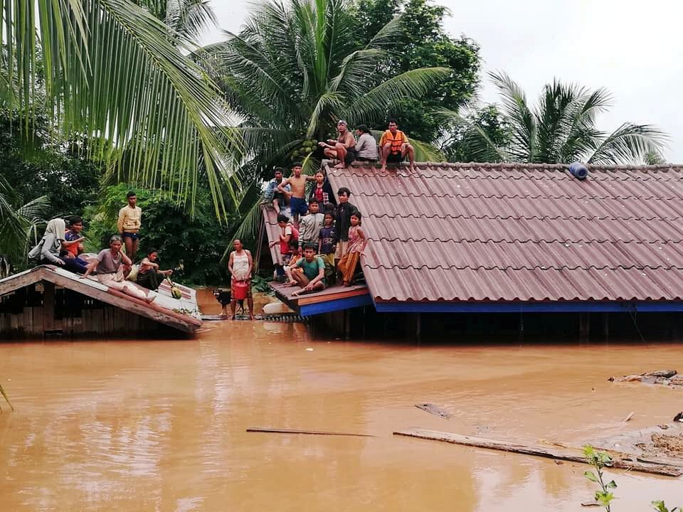 Villagers fled to the roofs of their homes after the Xepian-Xe Nam Noy hydropower dam collapsed in Attapeu province, Laos