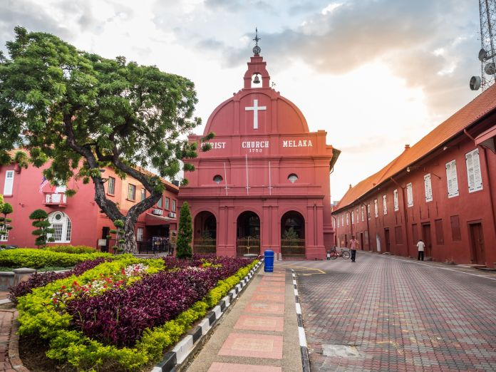 """While driving to the Cameron Highlands, Nick and Rachel stop in the town of Malacca to see the """"distinctive crimson-hued faca"""