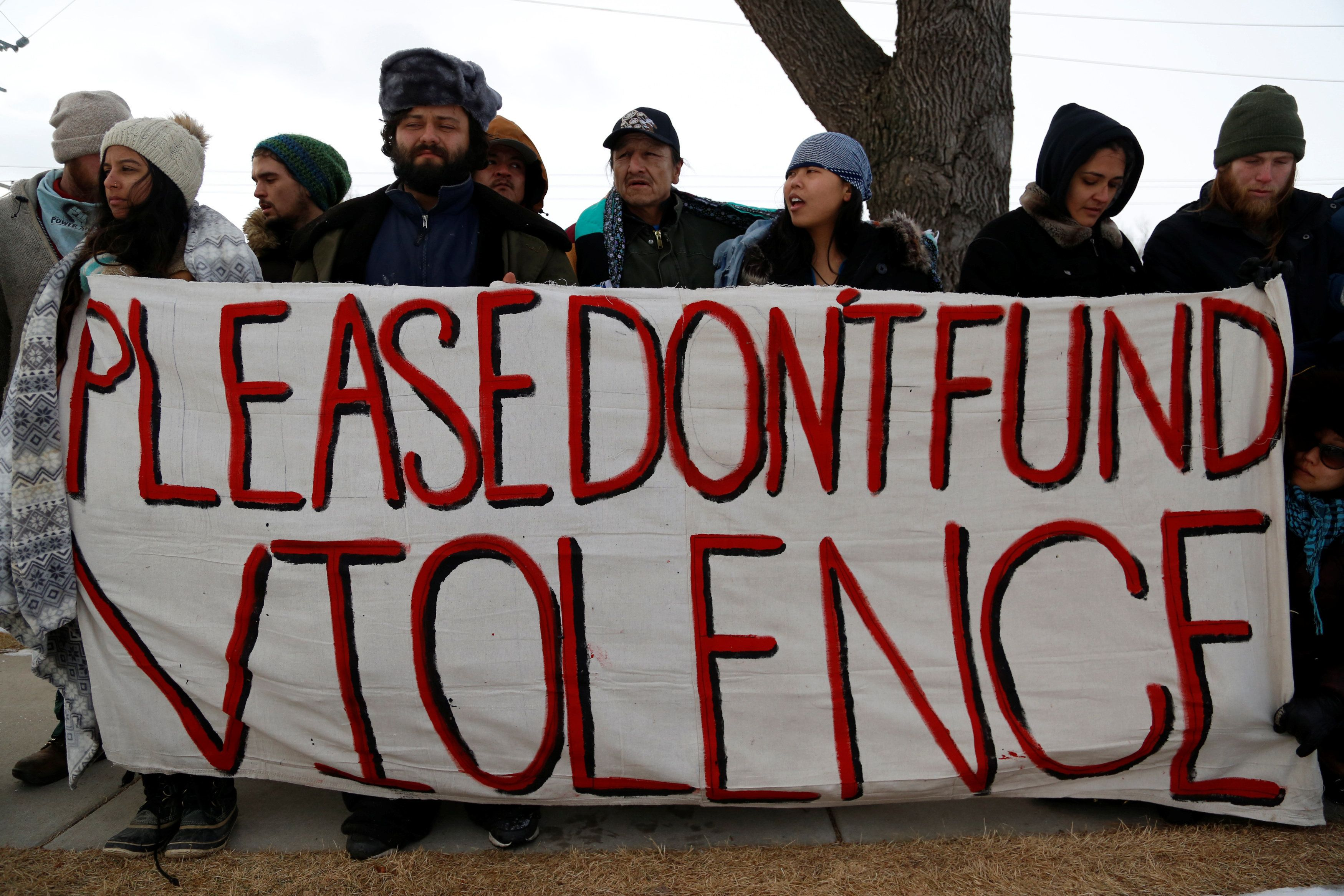 Opponents of the Dakota Access oil pipeline outside the Bank of North Dakota in Bismarck, North Dakota, January 31, 2017