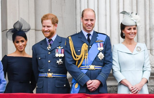 The Duke and Duchess of Sussex stand alongside the Duke and Duchess of Cambridge on the balcony of Buckingham Palace on July