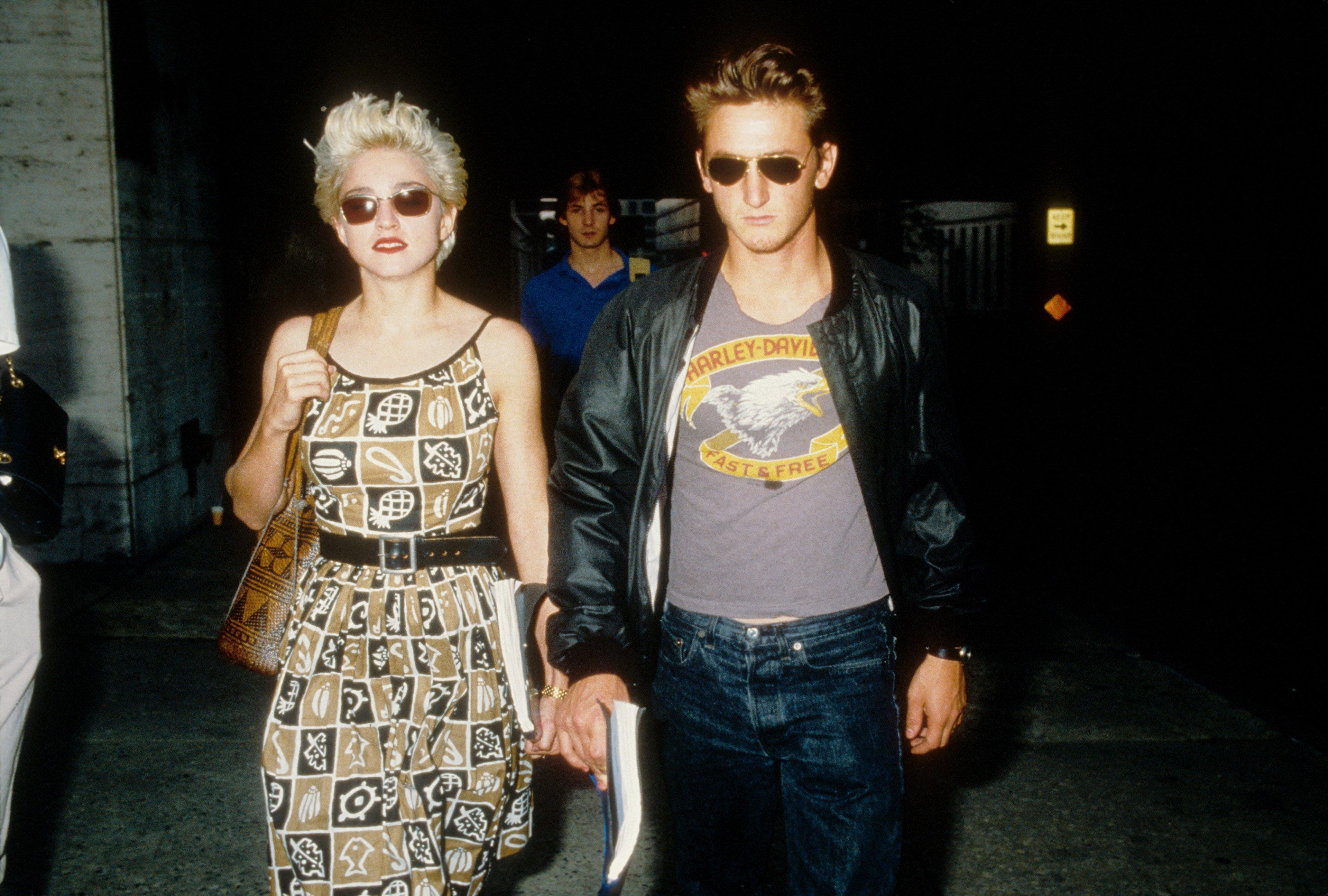 "Madonna<a href=""https://www.etonline.com/news/170048_madonna_posts_pda_pic_with_sean_penn_ahead_of_57th_birthday"" target=""_bl"