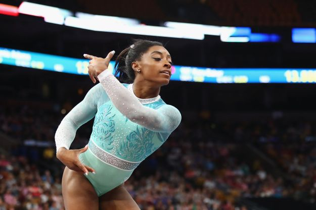 Simone Biles performs in a teal outfit during the floor exercise on Aug. 19.