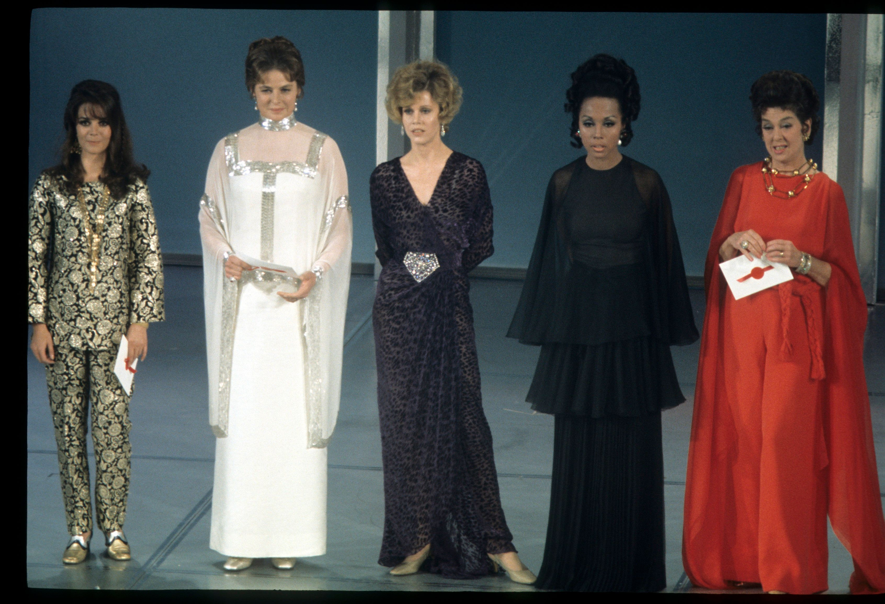 Here, the actress, standing beside Jane Fonda, wore a white and silver gown to present an award at the Academy Awards in 1969