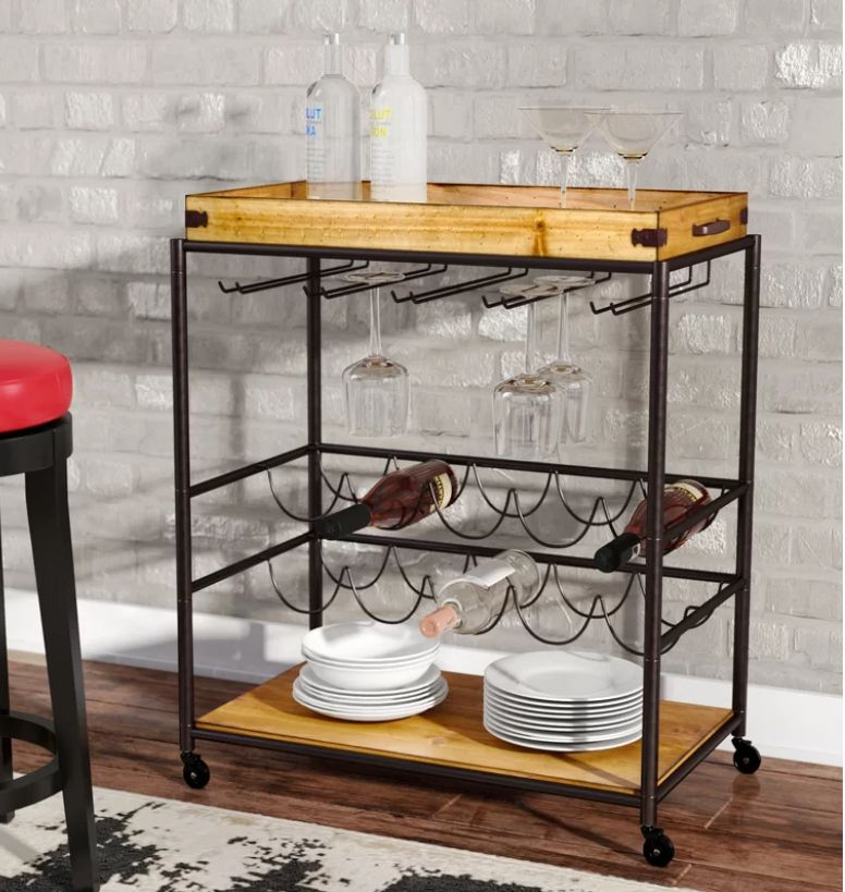 "Normally $259, on sale for $108.<br>Get it <a href=""https://www.wayfair.com/furniture/pdp/trent-austin-design-kahnah-bar-cart"