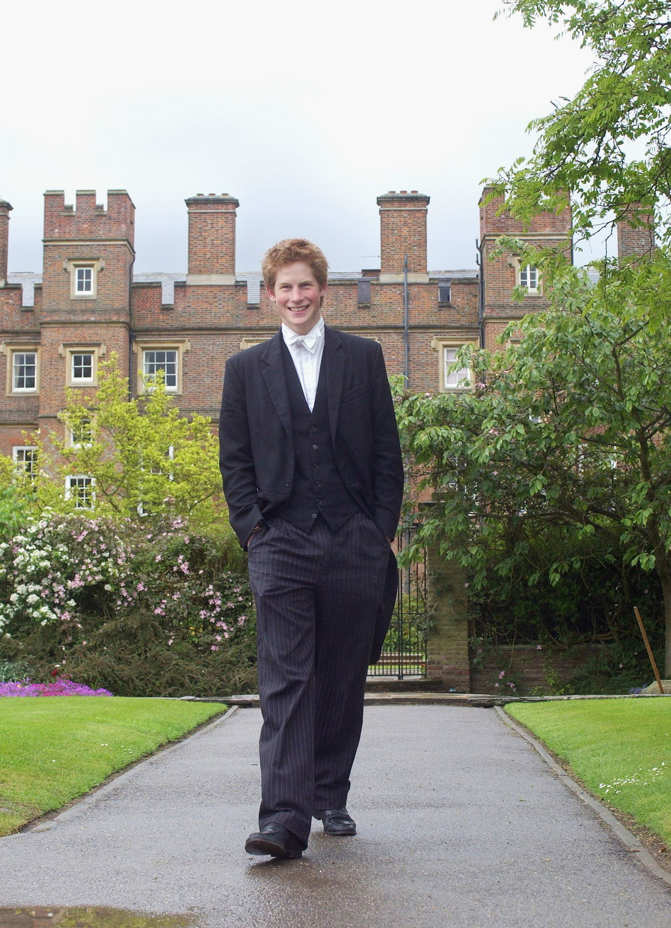Prince Harry wearing his school dress, which consists of a black tailcoat, a waistcoat and pin-striped trousers, in March 200