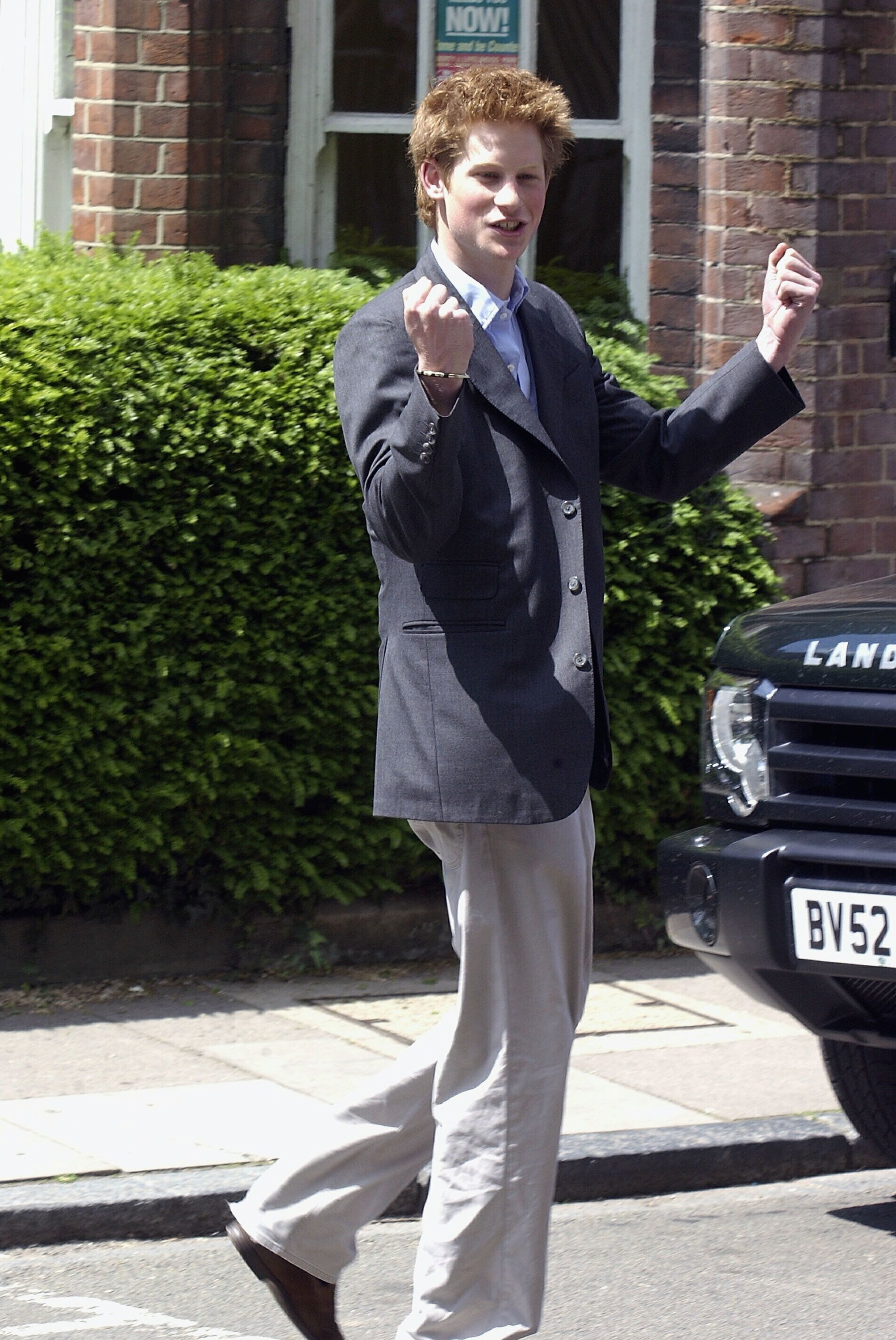 Prince Harry clenches his fist as he leaves Eton College on June 12, 2003.