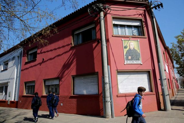 Children walk past the Antonio Provolo Institute in La Plata, Argentina, Thursday Sept 6, 2018.
