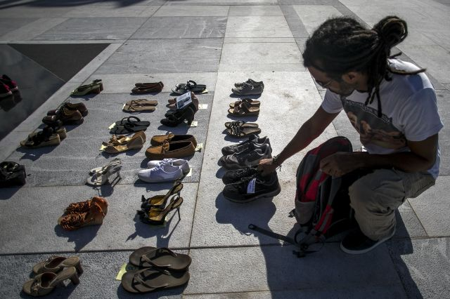 A demonstrator places an empty pair of shoes outside the Capitol building in San Juan, Puerto Rico, during a June 1, 2018, pr