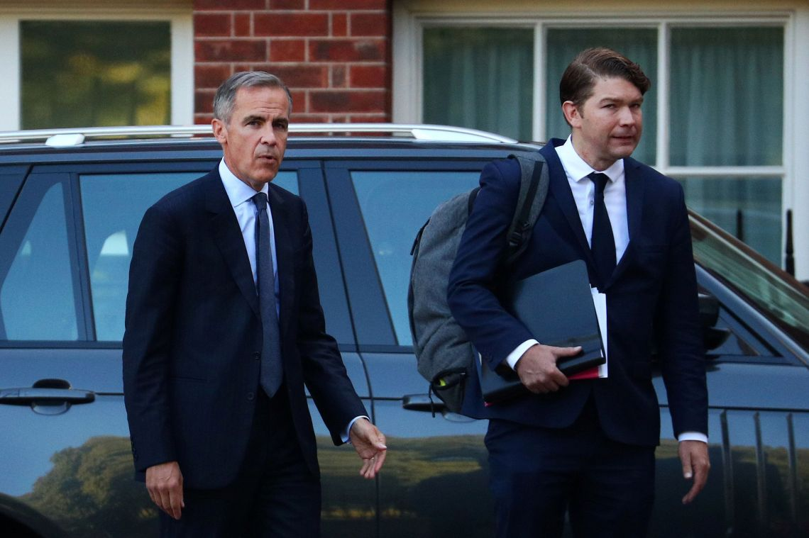 Mark Carney (left) and his private secretary leaving Downing Street on Thursday