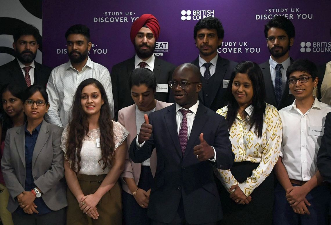 Sam Gyimah, pictured above meeting with Indian students go got scholarships in the UK, has written to university Vice Chancellors