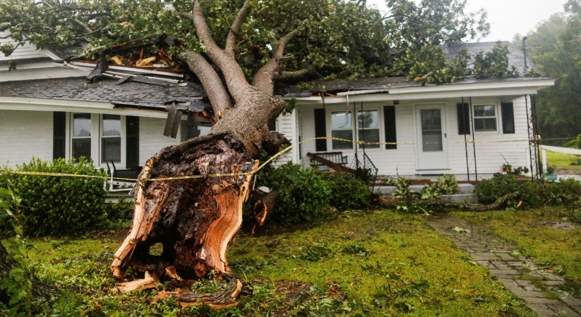 A downed tree rests on a house during the passing of Hurricane Florence in the town of Wilson, North Carolina.