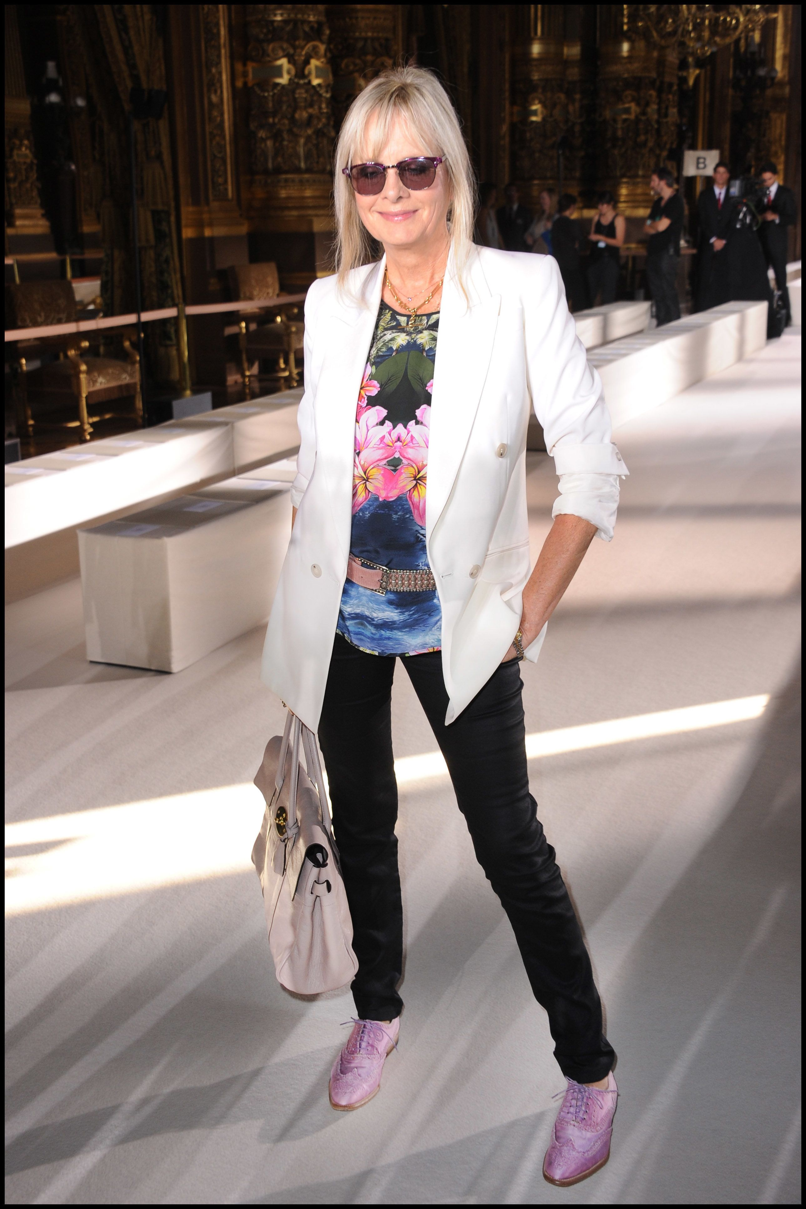 Twiggy attends the Stella McCartney ready-to-wear spring/summer 2012 show during Paris Fashion Week.