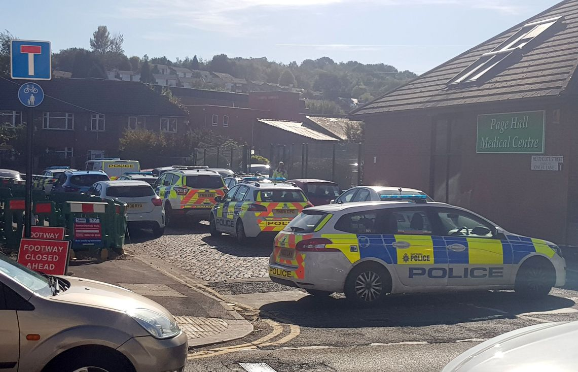 Police at the scene outside Fir Vale School in Sheffield, which had to close early following an 'incident'.