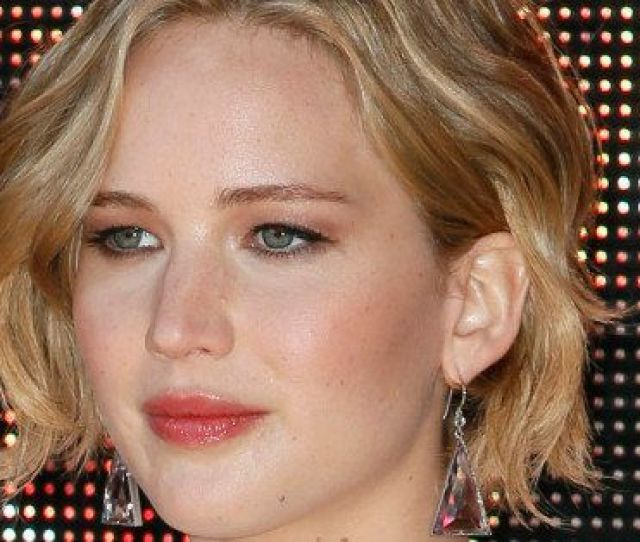 Actress Jennifer Lawrence Poses For Photographers During A Photo Call For Hunger Games Mockingjay Part