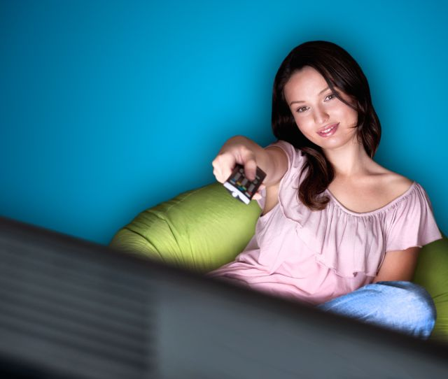 Young Woman Watching Tv Sitting