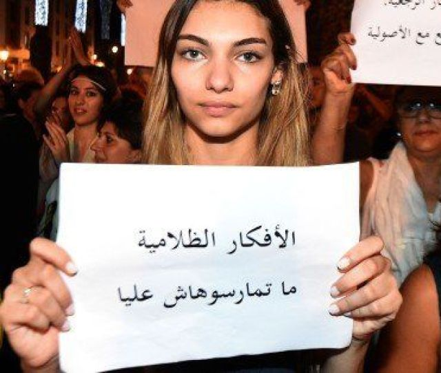 Moroccans Shout Slogans And Hold Placards During A Demonstration In Rabat On July