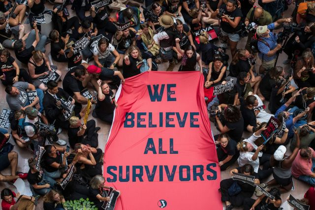 Protestors rally against Kavanaugh in the atrium of the Hart Senate Office Building on Capitol Hill on Oct. 4, 2018.