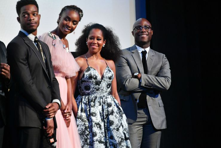 """Left to right: Stephan James, KiKi Layne, Regina King, and Barry Jenkins speak onstage at the """"If Beale Street Could Talk"""" U."""