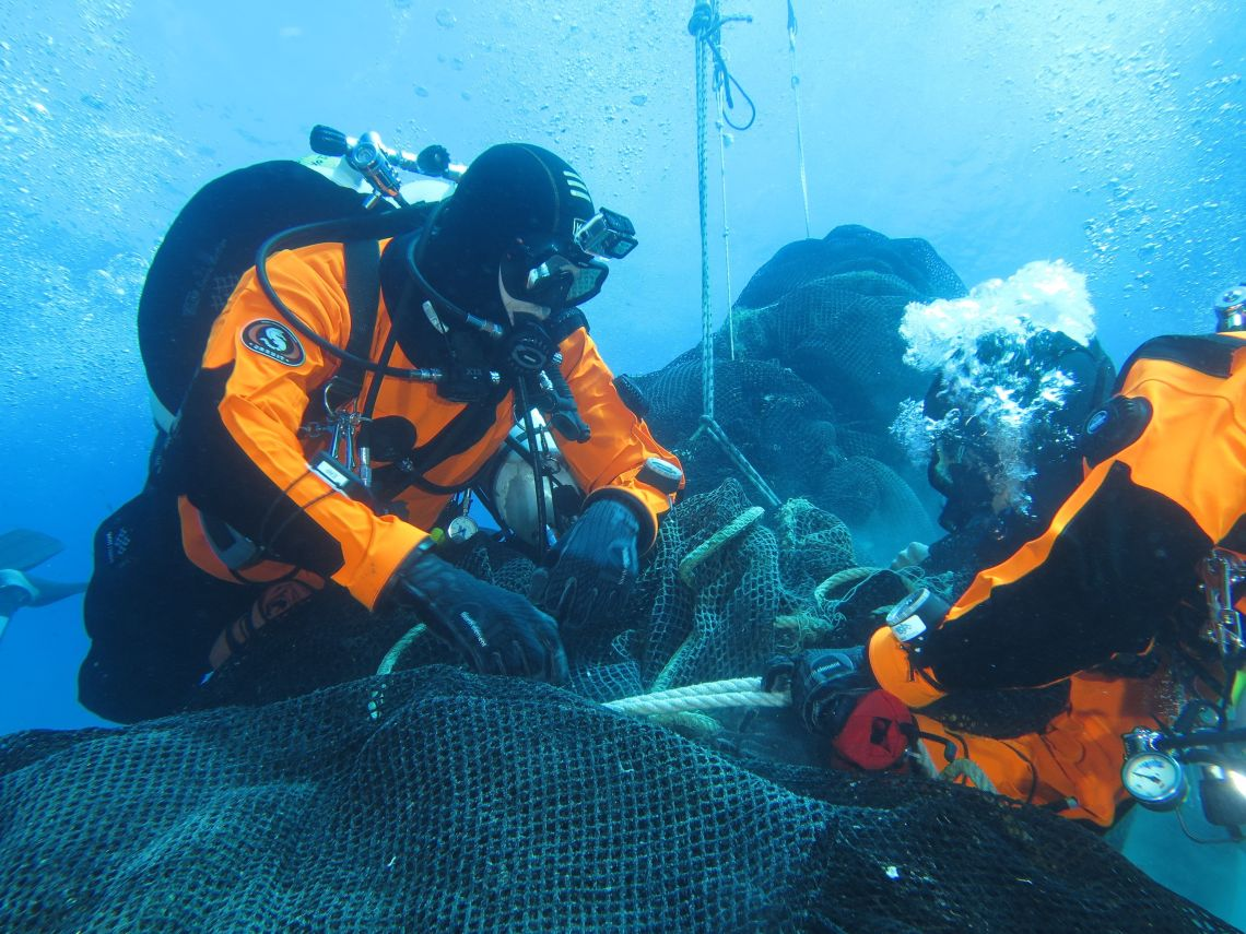 Divers work to recover a massive fishing net abandoned a decade ago off the coast of the Aeolian Islands.