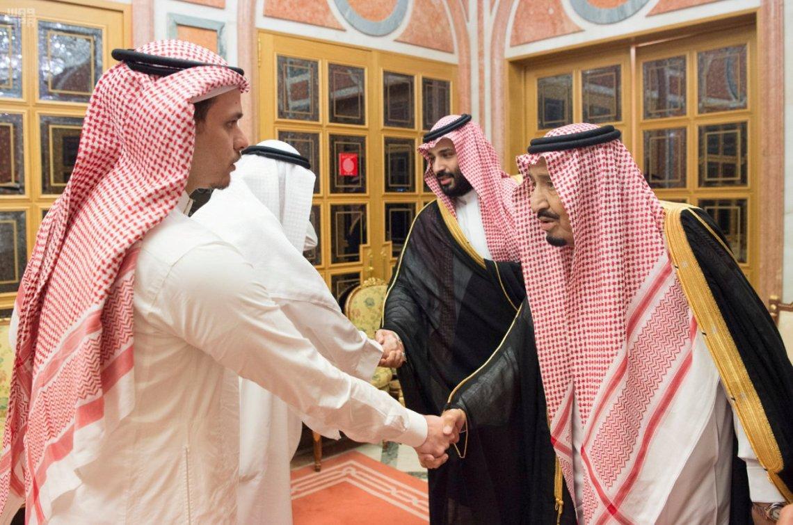 Saudi King Salman and crown prince bin Salman shaking hands with members of Khashoggi's family including his son