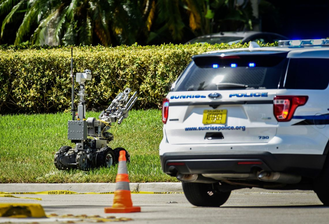 A bomb defusing robot is sent into the Sunrise Utility Administrative Centre in Sunrise, Florida, after a suspicious package was discovered in the building where Congresswoman Deborah Wasserman Schultz's office is located.