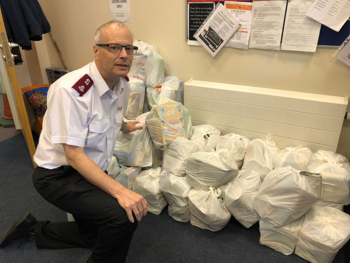 Major Alex Cadogan with some of the food bags ready for collection at the Salvation Army foodbank in Preston