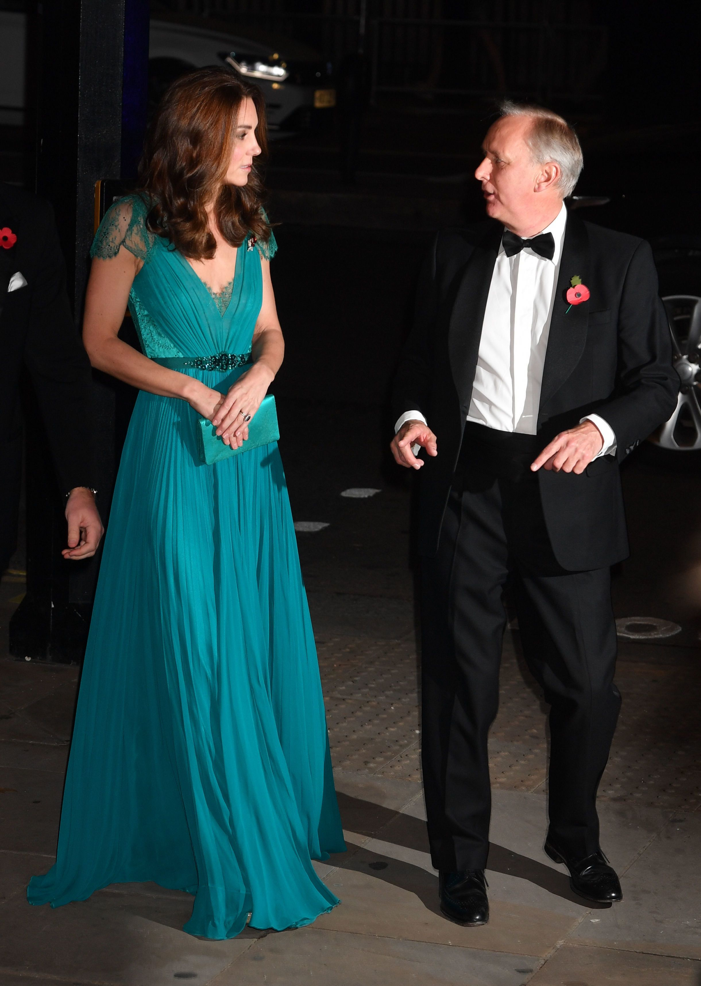 The Duchess of Cambridge talks with the chief executive of Tusk, Charles Mayhew.