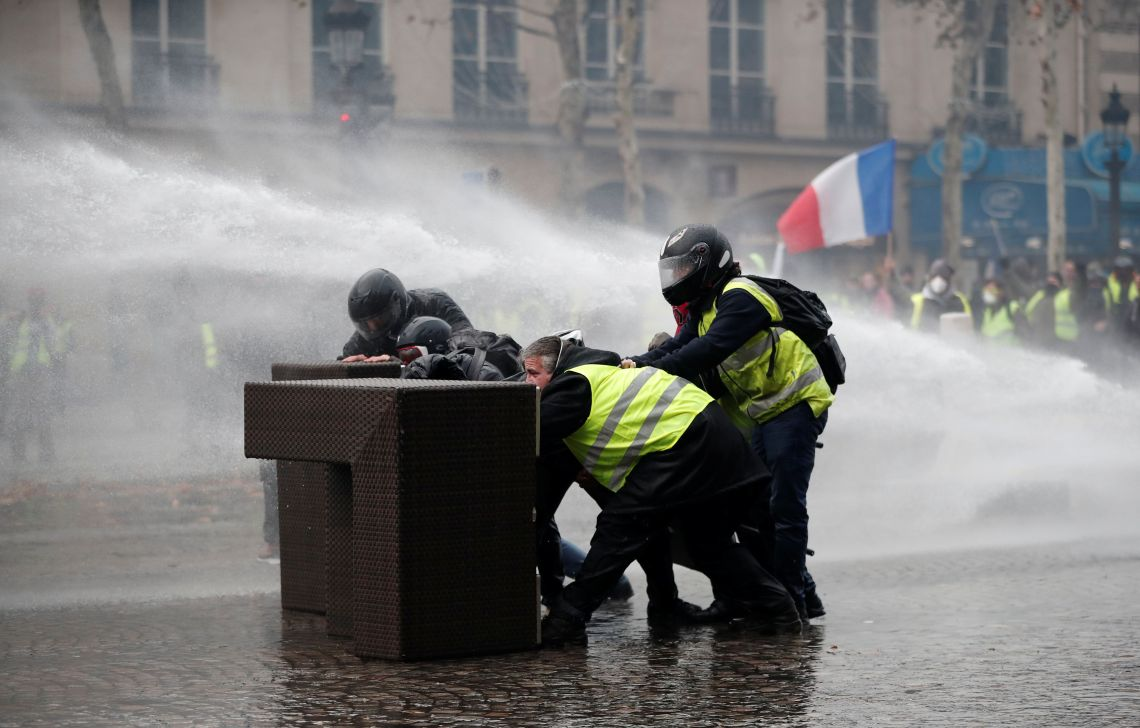 Protestors take over as police use a water canon