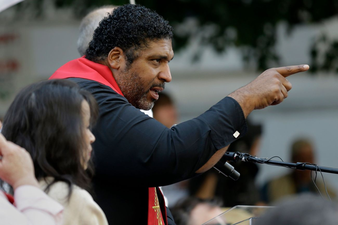 Rev. William Barber, President of the North Carolina Chapter of the NAACP, leads a Moral Monday protest against actions taken