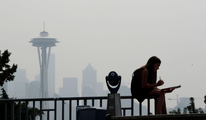 A photo shows thesmoky haze that obscured the Space Needle and downtown Seattle in August 2018.