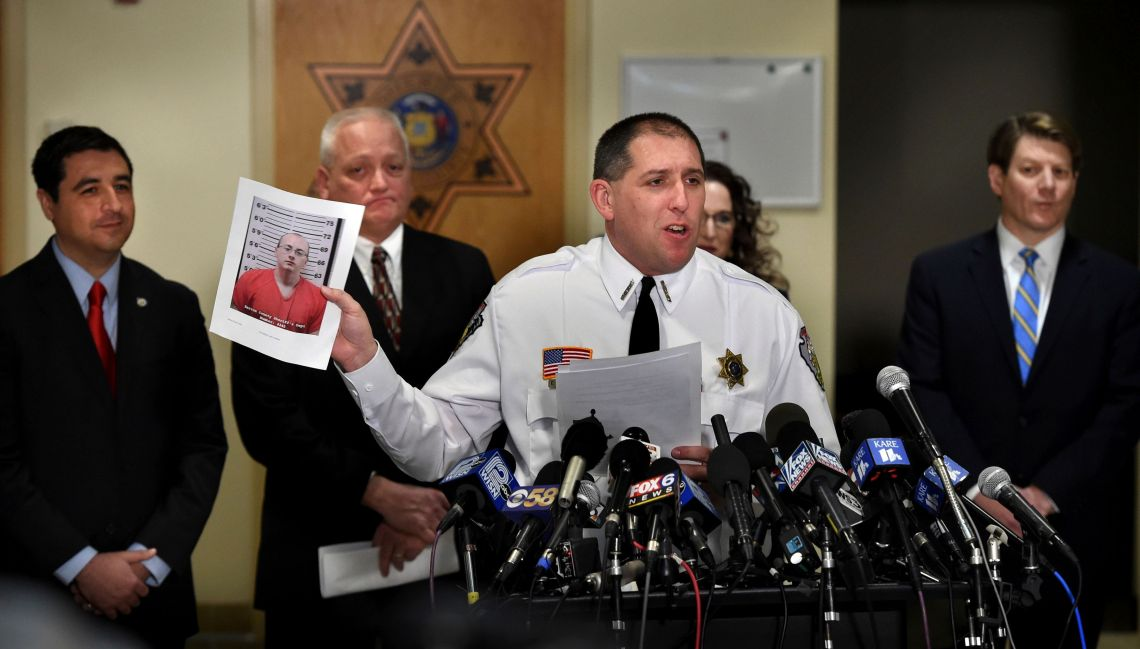 Barron County Sheriff Chris Fitzgerald holds up the booking photo of Jake Thomas Patterson, who allegedly kidnapped Jayme Closs, during a press conference last week