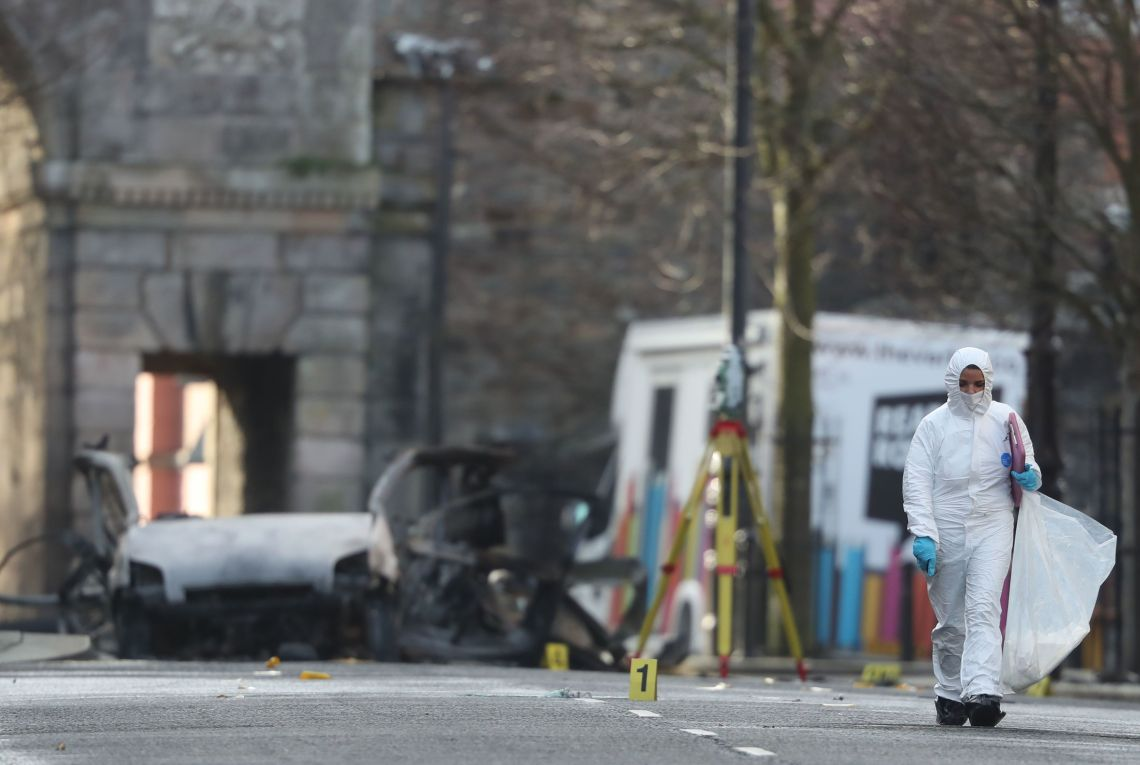 Forensic investigators at the scene of a car bomb blast on Bishop Street in Londonderry