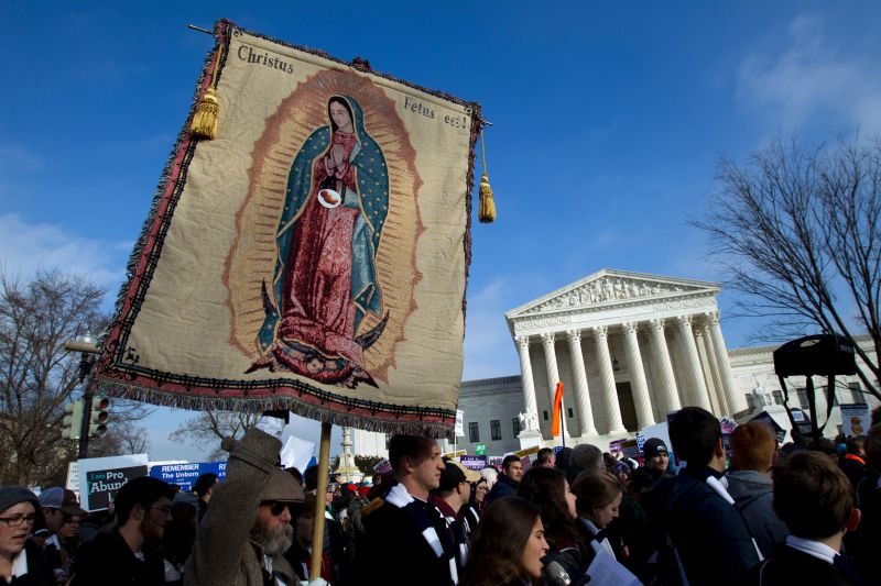 Anti-abortiondemonstrators pass the Supreme Court during the March for Life, Jan. 18. The Covington students were in th