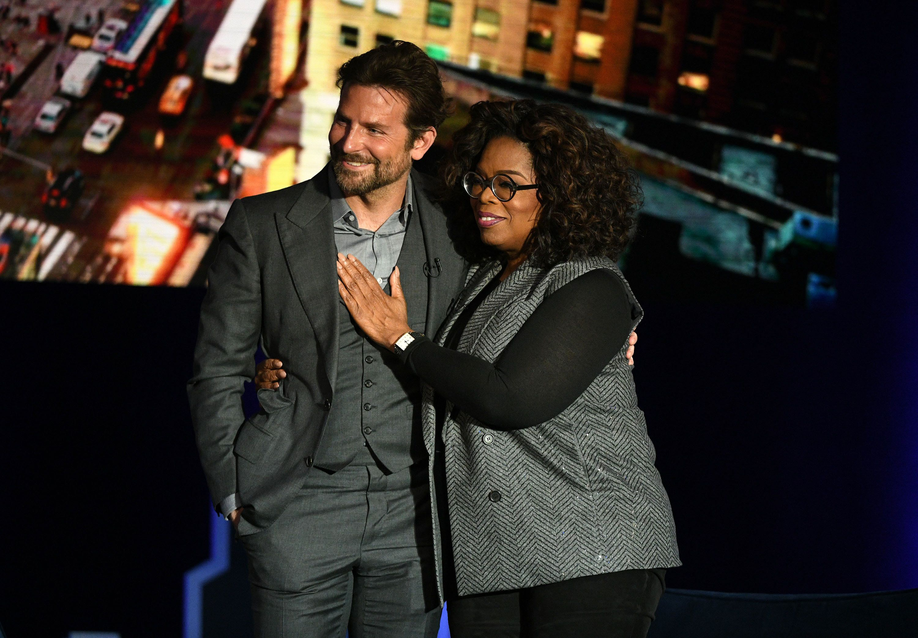 Bradley Cooper and Oprah Winfrey pose together during the talk show host's SuperSoul Conversations From Times Square.