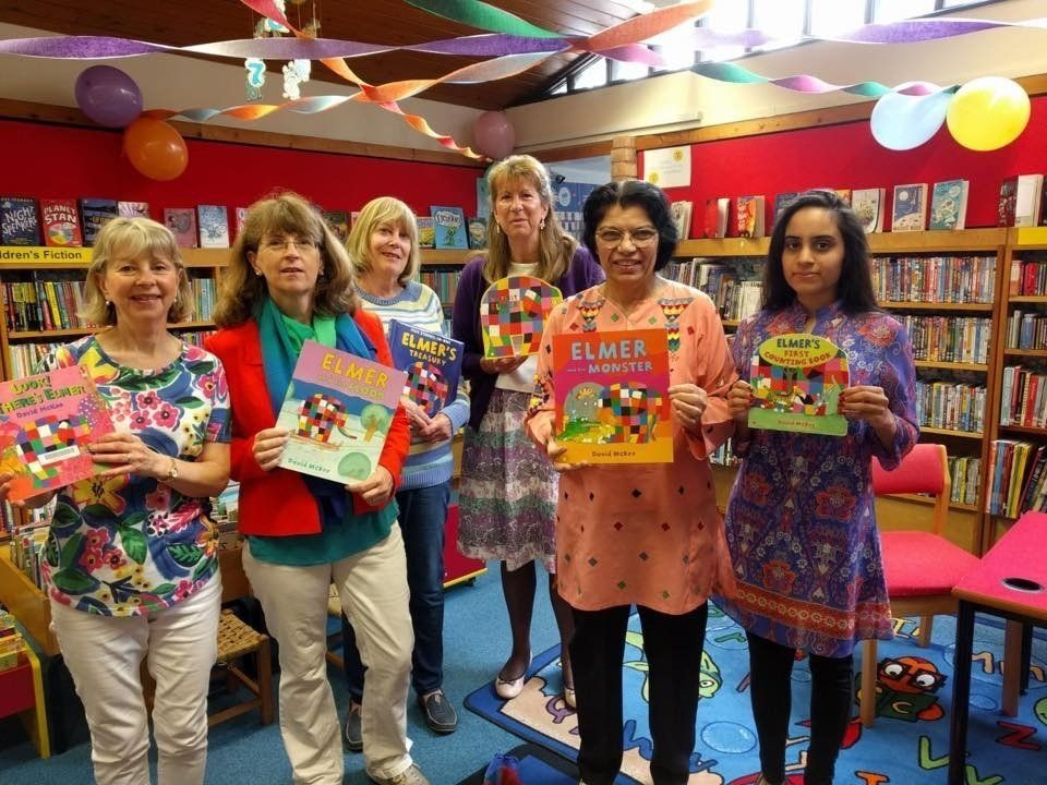 A group of volunteers all looking colourful on Elmer Day – a special event organised for children at the library. Chris is the third from the right.