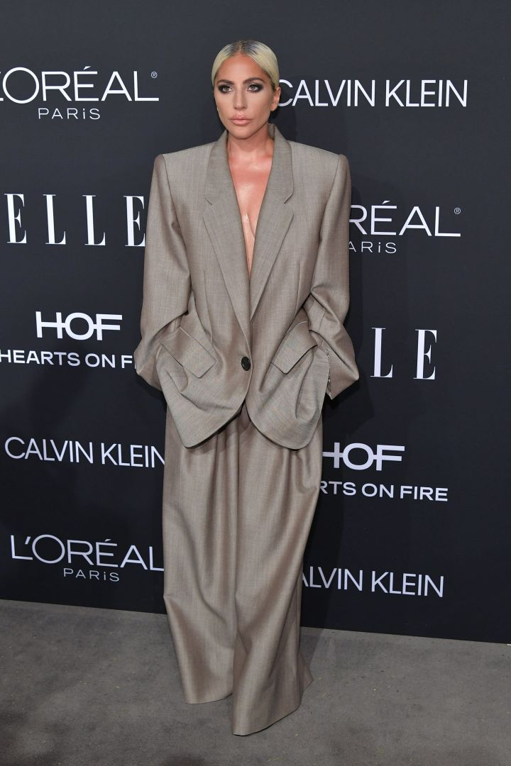 Lady Gaga wears an oversized Marc Jacobs suit at the 2018 Elle Women in Hollywood celebration.