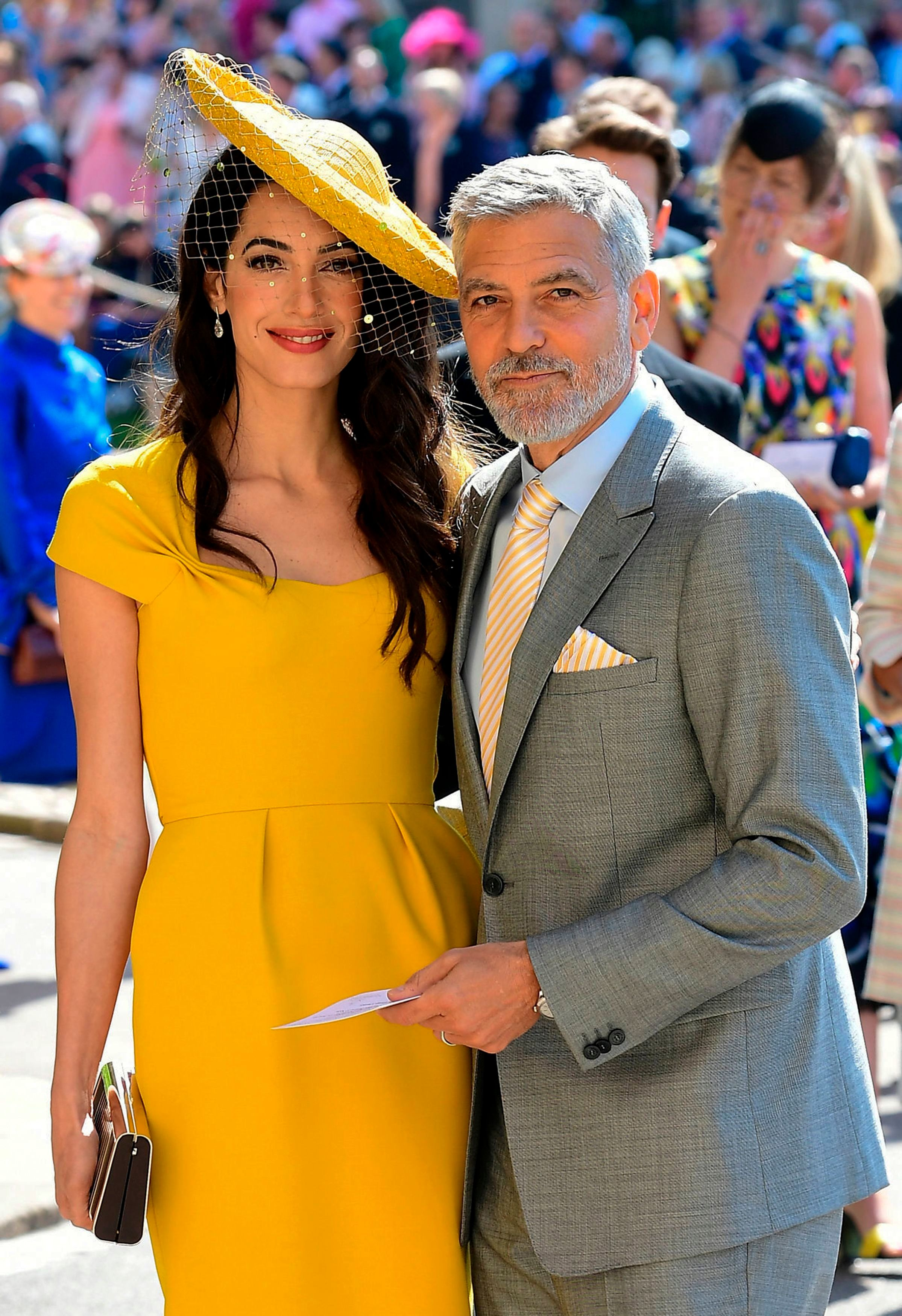 Amal and George Clooney pose together on the day of the royal wedding at St George's Chapel, Windsor Castle, in Windsor, on M