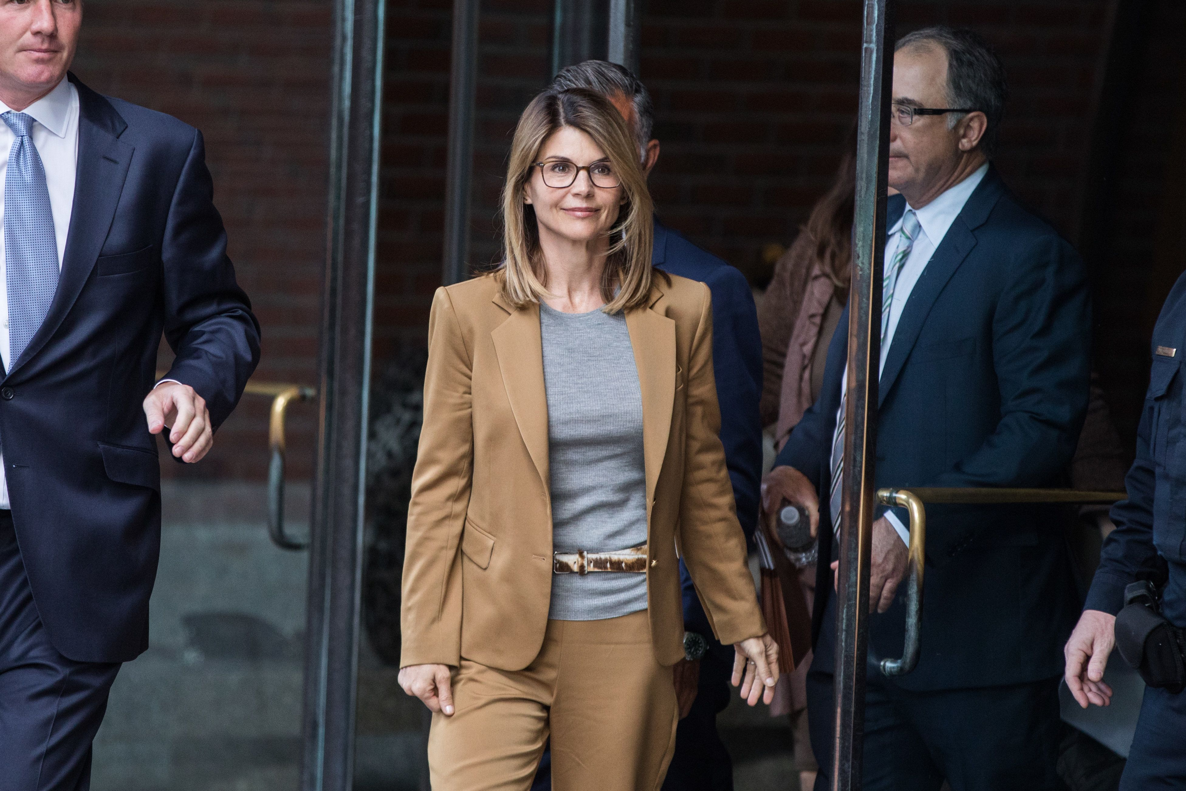 Actress Lori Loughlin, center, exits federal court in Boston, Massachusetts, U.S., on Wednesday, April 3, 2019. She and her h