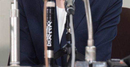 会見に臨んだ冨田真由さん
