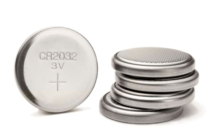 Button batteries look like small metal buttons.